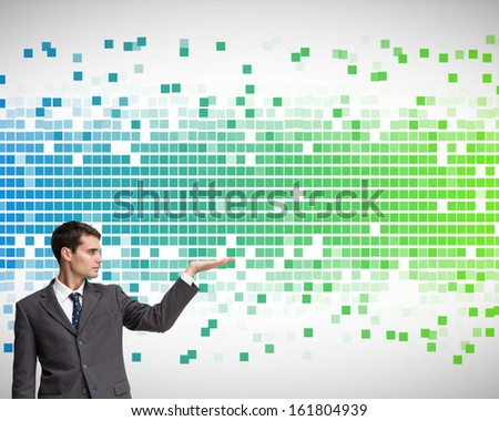 Composite image of stern attractive businessman presenting - stock photo