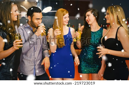 Composite image of Talking friends at a bar against snow falling