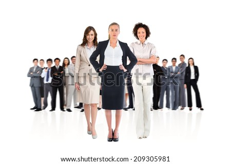 Composite image of team of businesswomen looking at camera on white background - stock photo