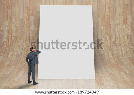 Composite image of thinking businessman against white card