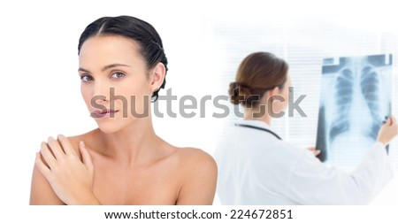 Composite image of thoughtful young model posing looking at camera - stock photo
