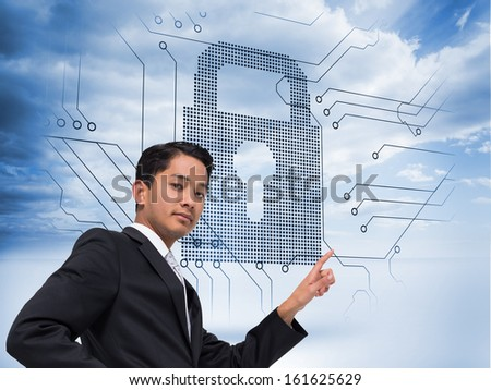 Composite image of unsmiling asian businessman pointing - stock photo