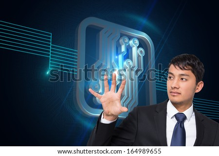 Composite image of unsmiling businessman holding and pointing