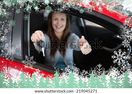 Composite image of woman holding car keys against snow - stock photo