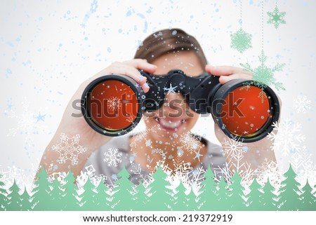 Composite image of woman looking through spyglasses against snowflakes and fir trees in green - stock photo