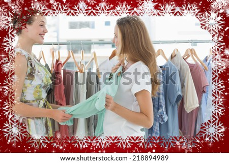 Composite image of women shopping in clothes store against snow