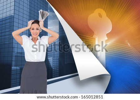 Composite image of worried stylish businesswoman holding newspaper