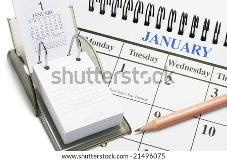 Composite of Calendars and Pencil
