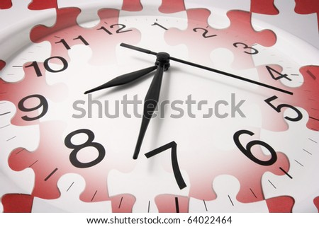 Composite of Clock and Jigsaw Puzzle - stock photo