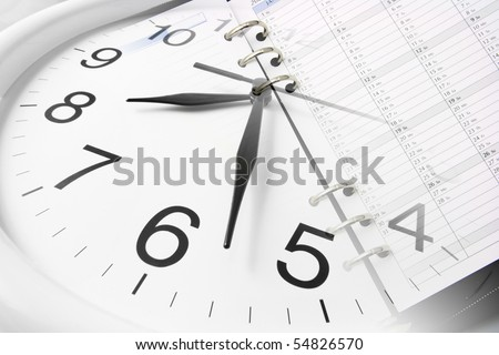 Composite of Clock and Planner - stock photo