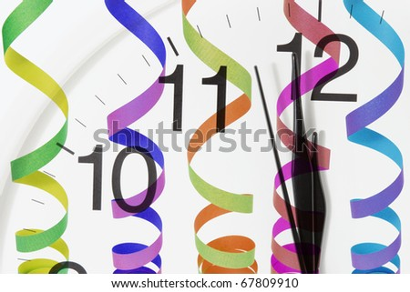 Composite of Clock Face and Streamers - stock photo