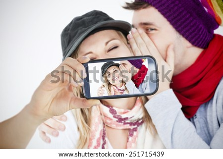 Composite of Couple taking selfie on smartphone - stock photo