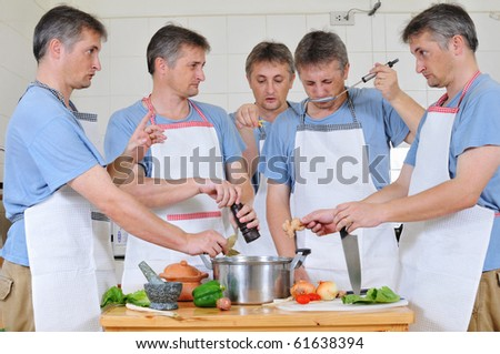 Composite of five cloned men trying to cook together but too many cooks have spoiled the broth - stock photo