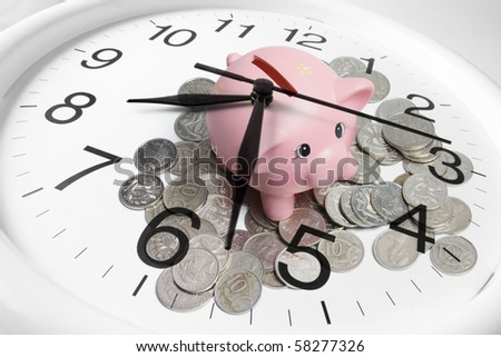 Composite of Piggy bank and Clock - stock photo