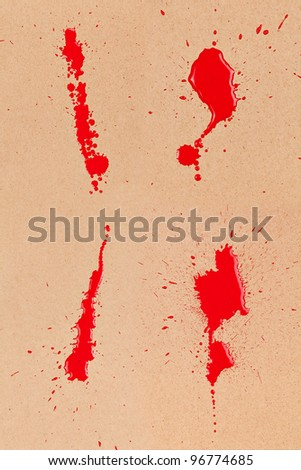 Composite of 4 red/blood stains and spatter on brown cardboard. - stock photo