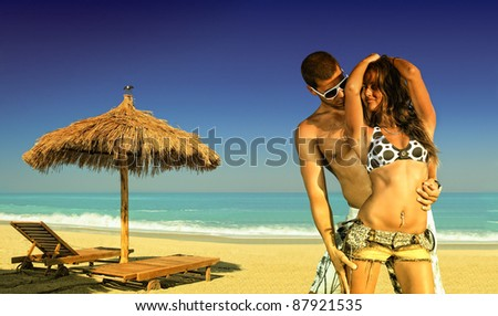 Composite picture of a couple on the beach - Summer ravel concept - stock photo