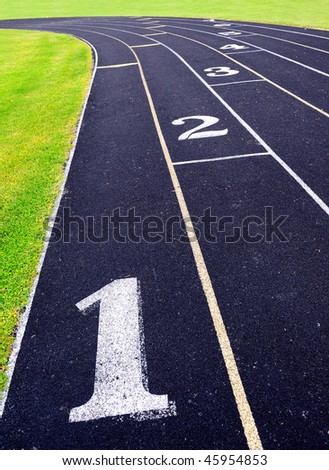 Composite running track at high school stadium