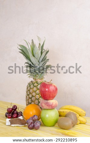 Composition basket fresh fruit over  yellow wooden. - stock photo