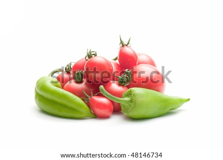 composition from a pepper and tomato on the white isolated background