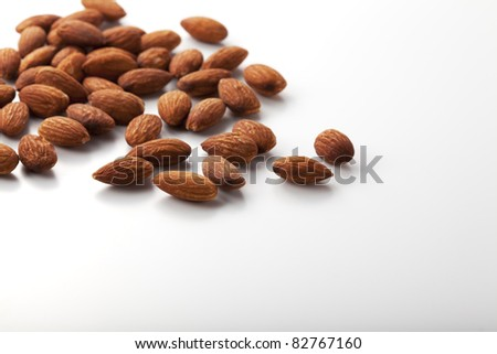 Composition from almond nuts isolated on white background.