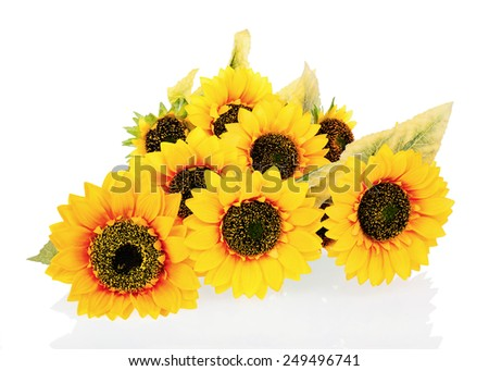 Composition from bright artificial sunflowers isolated on white background. Closeup. - stock photo