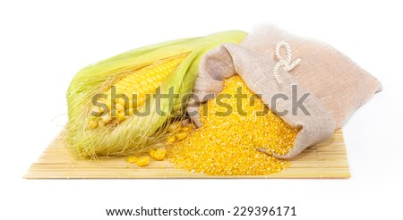 Composition from corn, maize flour in sack on the mat isolated on white background - stock photo