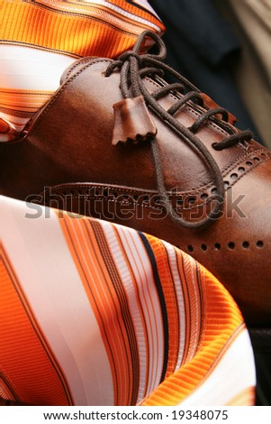 Composition from leather boots and tie - stock photo