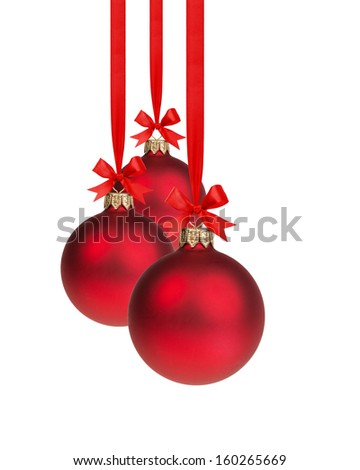 composition from three red christmas balls hanging on ribbon, white background - stock photo