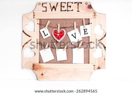 Composition: instant photo frame. Pinned and hanging photos on rope with lovely plush - stock photo