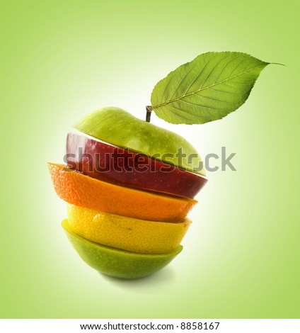 Composition made from pieces of apple,lemon  and orange  on isolated green background - stock photo
