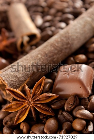 Composition of anise, cinnamon, choco and coffee beans - stock photo