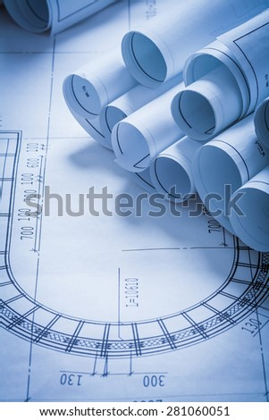 Composition of blueprint rolls construction concept  - stock photo