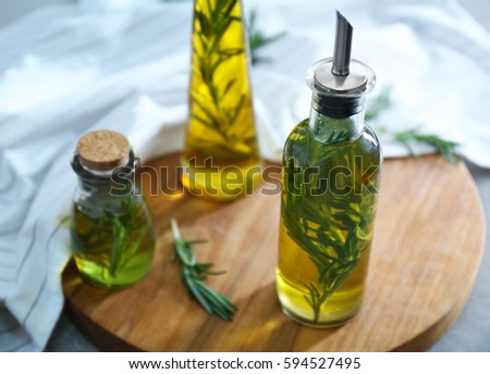 Composition of bottles with oil on wooden stand