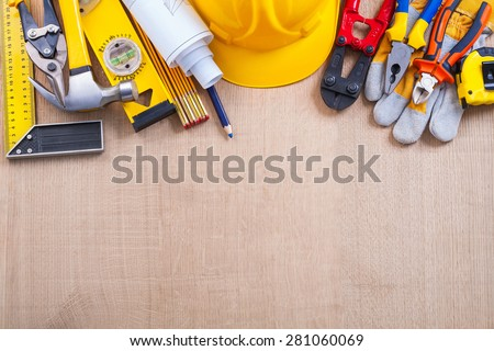 Composition of building tools on oak wooden board construction concept  - stock photo