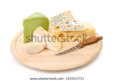 Composition of cheese on wooden plate. Isolated on a white background.