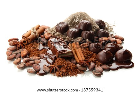 Composition of chocolate sweets, cocoa and spices, isolated on white - stock photo