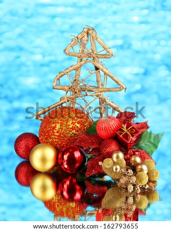 Composition of Christmas balls on blue background - stock photo