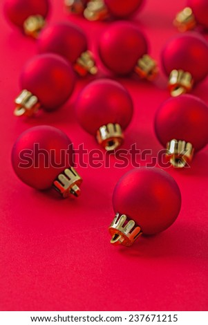 composition of christmas baubles on red background - stock photo