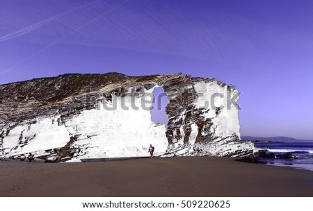 composition of cliffs and beaches,photography surreal beach Cathedrals, Lugo, Galicia, Spain, abstract surrealism,Stone arches formed by the erosion of the sea and the wind,