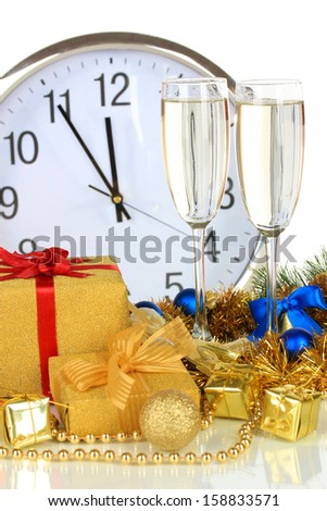 Composition of clock and christmas decorations isolated on white