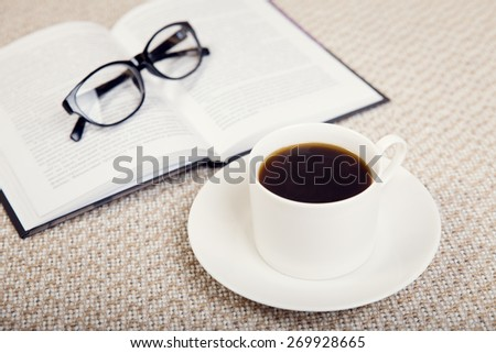 Composition of  coffee cup with book and glasses