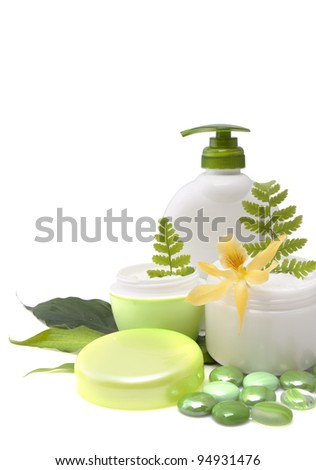 Composition of cosmetic products with flower on white background - stock photo