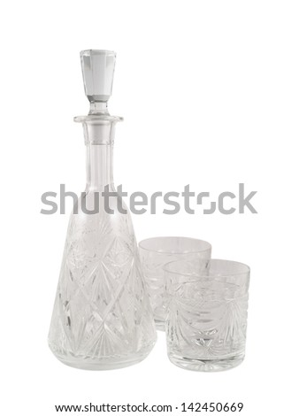 Composition of crystal glass decanter vessel with the two tumblers isolated over white background - stock photo