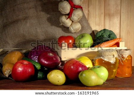 Composition of different fruits and vegetables on table on sackcloth background