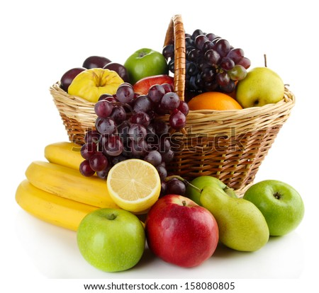 Composition of different fruits with basket isolated on white - stock photo