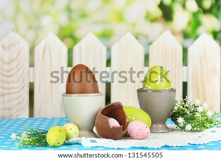 Composition of Easter and chocolate eggs on natural background - stock photo