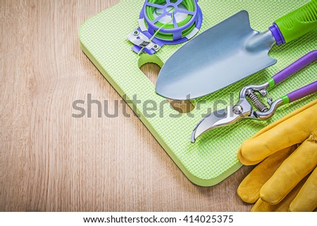Composition of farming tools on wooden board gardening concept. - stock photo