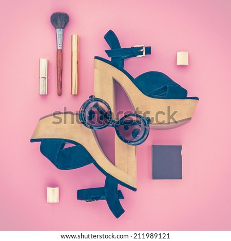 Composition of female accessories and shoes on a pink background - stock photo