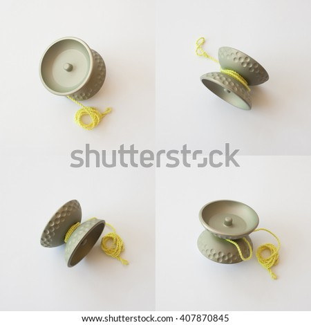 composition of four image of the same aluminum yoyo with anodized finish with yellow string - stock photo
