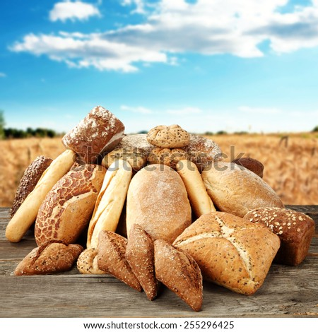 composition of fresh bread and sky of blue  - stock photo